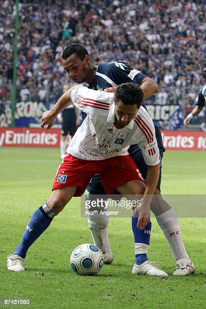 Marvin Matip of Koeln challenges for the ball with Albert Streit of Hamburg during the Bundesliga match between Hamburger SV and 1 FC Koeln at HSH...