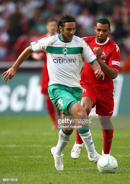Marvin Matip of Koeln follows Claudio Pizarro of Werder Bremen during the Bundesliga match between 1 FC Koeln and Werder Bremen at the RheinEnergie...