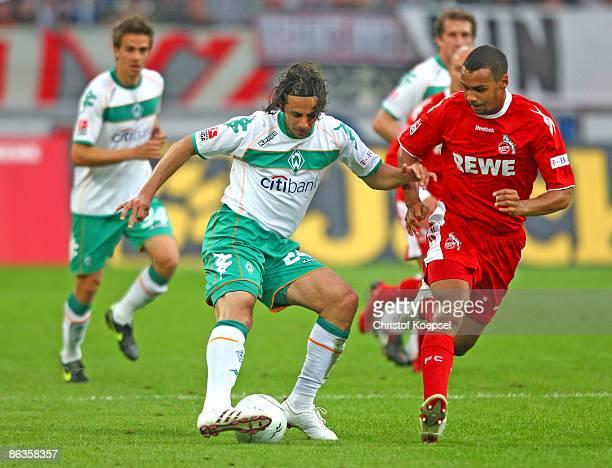 Marvin Matip of Koeln tackles Claudio Pizarro of Werder Bremen during the Bundesliga match between 1 FC Koeln and Werder Bremen at the RheinEnergie...