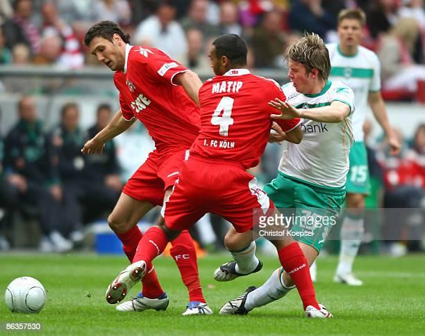 Marvin Matip of Koeln tackles Peter Niemeyer of Werder Bremen during the Bundesliga match between 1 FC Koeln and Werder Bremen at the RheinEnergie...