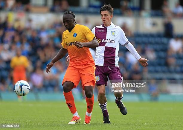 Marvin McCoy of Wycombe Wanderers and Jack Grealish of Aston Villa