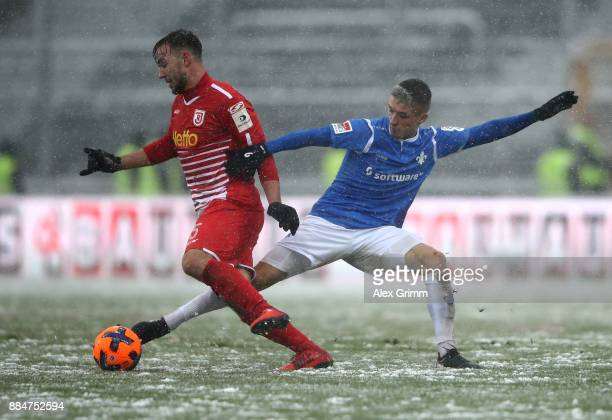 Marvin Mehlem of Darmstadt and Benedikt Gimber of Regensburg battle for the ball during the Second Bundesliga match between SV Darmstadt 98 and SSV...