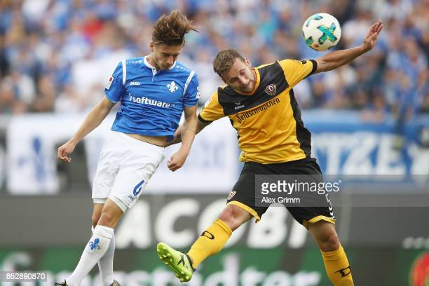 Marvin Mehlem of Darmstadt jumps for a header with Manuel Konrad of Dresden during the Second Bundesliga match between SV Darmstadt 98 and SG Dynamo...