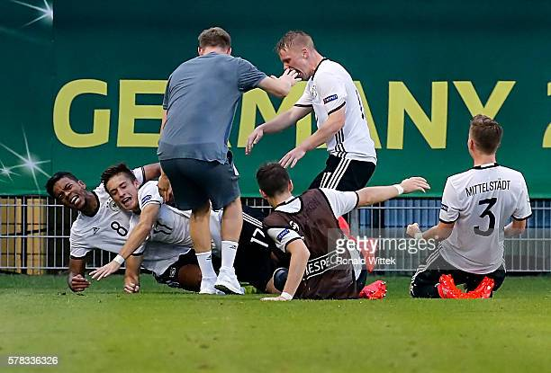 Marvin Mehlhem of Germany celebrates after scoring his team's third goal with his teammates during the UEFA Under19 European Championship match...