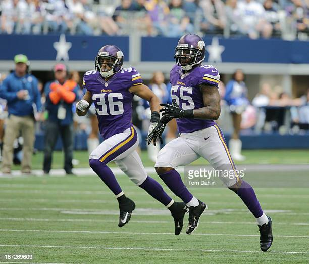 Marvin Mitchell and Robert Blanton of the Minnesota Vikings run downfield during an NFL game against the Dallas Cowboys at ATT Stadium November 3...