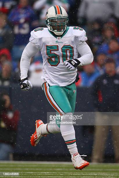 Marvin Mitchell of the Miami Dolphins in action during their NFL game against the Buffalo Bills at Ralph Wilson Stadium on December 18 2011 in...