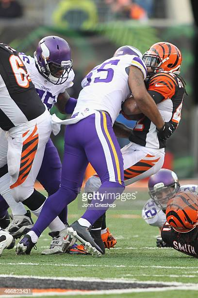 Marvin Mitchell of the Minnesota Vikings makes the tackle on BenJarvus GreenEllis of the Cincinnati Bengals during their game at Paul Brown Stadium...