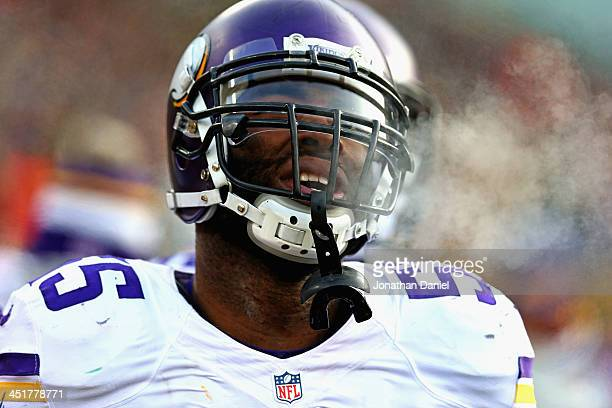 Marvin Mitchell of the Minnesota Vikings rests on the sidelines during a game against the Green Bay Packers at Lambeau Field on November 24 2013 in...