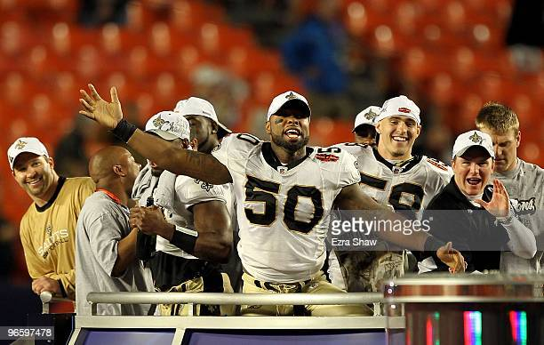 Marvin Mitchell of the New Orleans Saints and teammates celebrate after defeating the Indianapolis Colts during Super Bowl XLIV on February 7 2010 at...