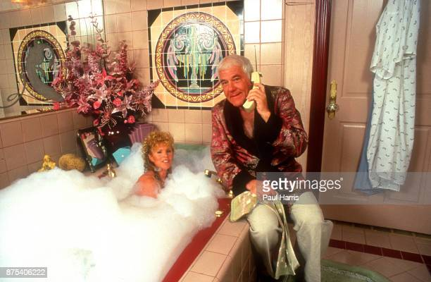 Marvin Mitchelson on the phone and his wife Marcella in the bath pose in their palatial home on January 1 1989 in West Hollywood California