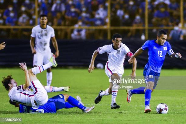 Marvin Monterrosa of El Salvador drives the ball while followed by Tyler Adams of the United States during a match between El Salvador and United...