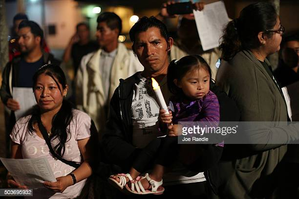 Marvin Pablo originally from Guatemala holds his daughter Lindsey Pablo as they join with others to protest against the deportation of undocumented...