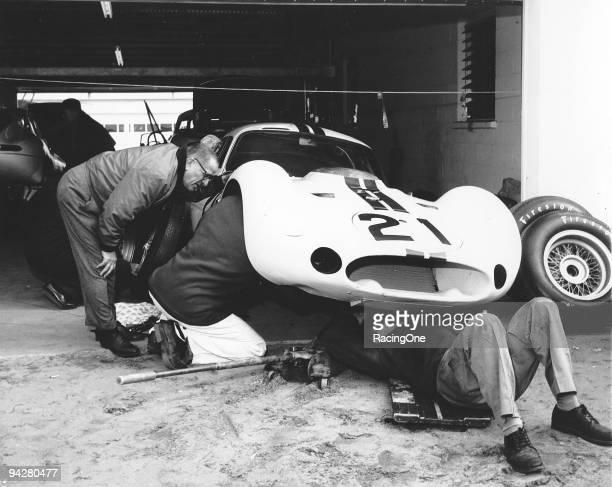 Marvin Panch works under the fender of a Maserati Tipo 151 which he was to drive in the American Challenge sports car race at Daytona Instead during...
