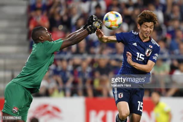 Marvin Phillip of Trinidad and Tobago and Yuya Osako of Japan compete for the ball during the international friendly match between Japan and Trinidad...