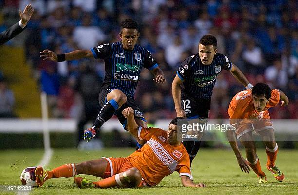 Marvin Pinon of Queretaro and Felipe Ayala of Corre Caminos fight for the ball during a match between Queretaro and Correcaminos as part of the...