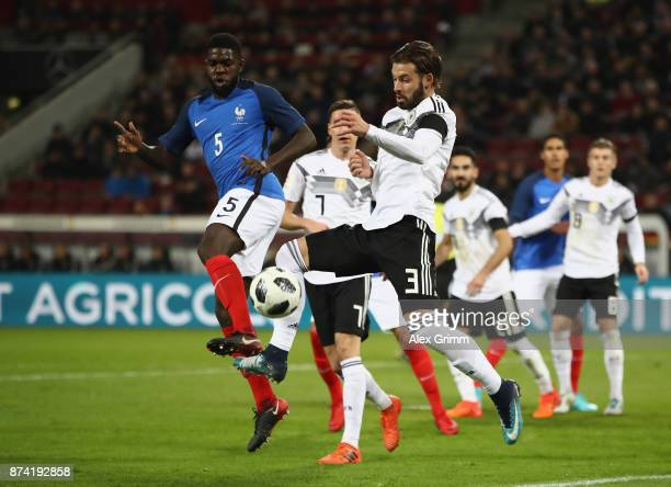 Marvin Planttenhardt of Germany clears the ball while under pressure from Samuel Umtiti of France during the international friendly match between...