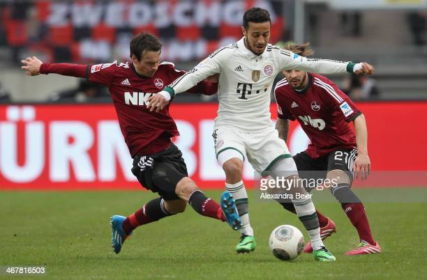 Marvin Plattenhardt and Markus Feulner of Nuernberg fight for the ball with Thiago of Muenchen during the Bundesliga match between 1 FC Nuernberg and...
