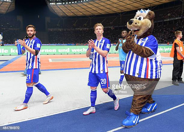 Marvin Plattenhardt Mitchell Weiser and mascot Herthinho of Hertha BSC during the game between Hertha BSC and Werder Bremen on August 21 2015 in...