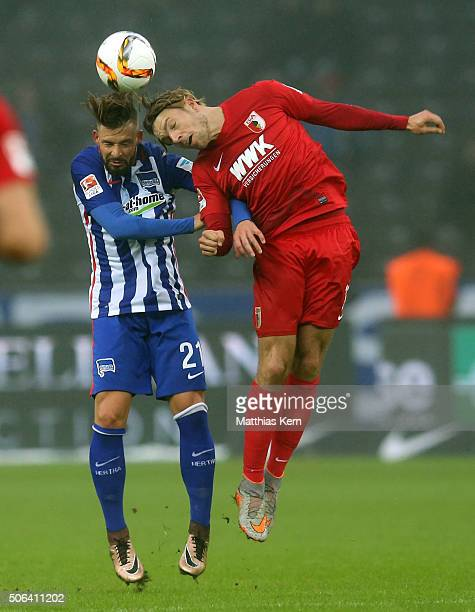 Marvin Plattenhardt of Berlin and Alexander Esswein of Augsburg jump for a header during the Bundesliga match between Hertha BSC and FC Augsburg at...