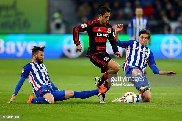 Marvin Plattenhardt of Berlin and Niklas Stark of Berlin challenge Chicharito of Leverkusen during the Bundesliga match between Bayer Leverkusen and...
