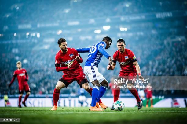 Marvin Plattenhardt of Berlin Breel Embolo of Schalke and Karim Rekik of Berlin in action during the Bundesliga match between FC Schalke 04 and...