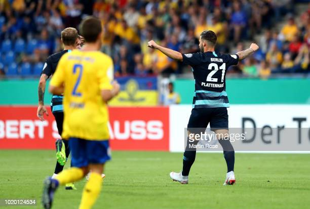 Marvin Plattenhardt of Berlin celebrates after he scores the opening goal during the DFB Cup first round match between Eintracht Braunschweig and...