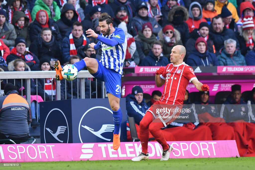 Marvin Plattenhardt of Berlin plays the ball as Arjen Robben of Bayern Muenchen is right behind him during the Bundesliga match between FC Bayern Muenchen and Hertha BSC at Allianz Arena on February 24, 2018 in Munich, Germany.