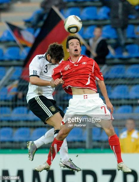 Marvin Plattenhardt of Germany and Janick Kamber of Switzerland jump up for a header during the EURO U19 Qualifier match between Germany and...