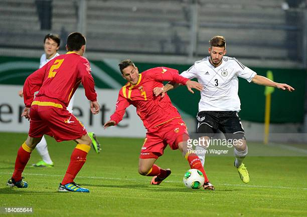 Marvin Plattenhardt of Germany battles for the ball with Marko Vukcevic of Montenegro during the U21 Euro qualifier group 6 match between Germany and...