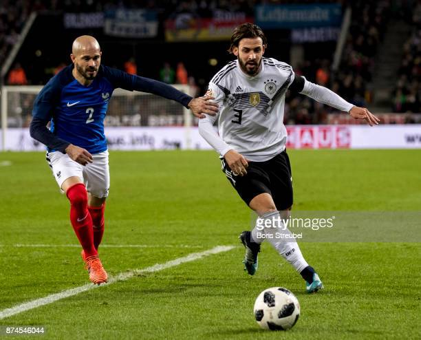 Marvin Plattenhardt of Germany is challenged by Christophe Jallet of France during the International friendly match between Germany and France at...