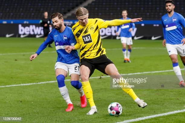 Marvin Plattenhardt of Hertha BSC and Erling Haaland of Borussia Dortmund battle for the ball during the Bundesliga match between Hertha BSC and...