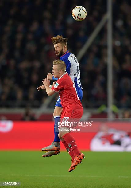 Marvin Plattenhardt of Hertha BSC and Stefan Thesker of Hannover 96 during the Bundesliga match between Hannover 96 and Hertha BSC at HDIArena on...