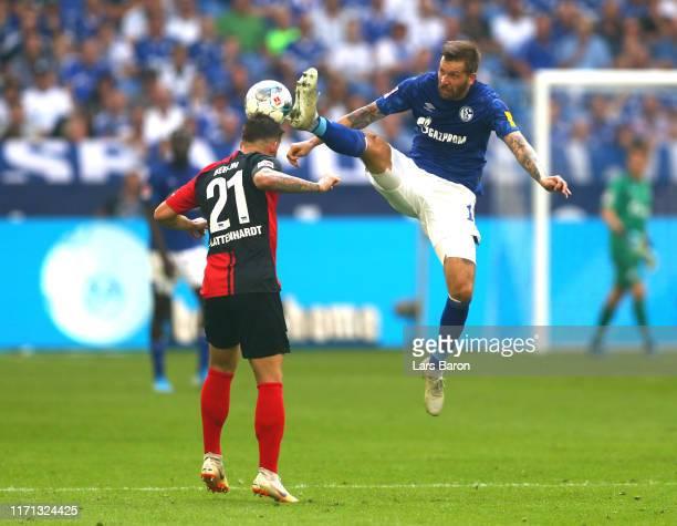 Marvin Plattenhardt of Hertha BSC is challenged by Guido Burgstaller of FC Schalke 04 during the Bundesliga match between FC Schalke 04 and Hertha...