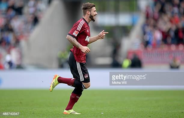 Marvin Plattenhardt of Nuernberg celebrates after scoring his team's first goal during the Bundesliga match between 1 FC Nuernberg and Bayer...