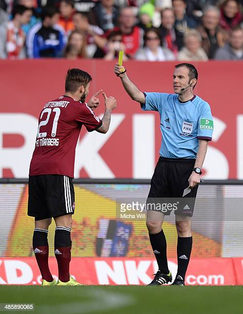Marvin Plattenhardt of Nuernberg discusses with refere Marco Fritz while beeing booked yellow card during the Bundesliga match between 1 FC Nuernberg...
