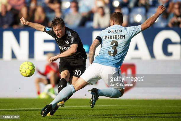 Marvin Pourié of Randers FC and Marc Pedersen of SonderjyskE in action during the Danish Alka Superliga match between SonderjyskE and Randers FC at...