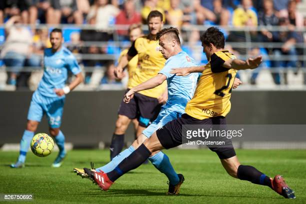 Marvin Pourié of Randers FC and Rasmus Minor Petersen of Hobro IK compete for the ball during the Danish Alka Superliga match between Hobro IK and...