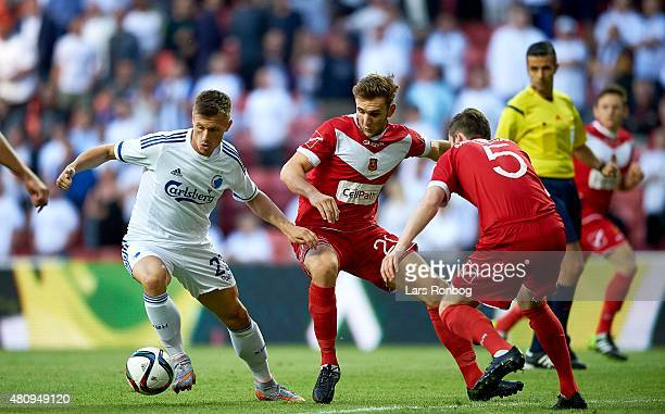 Marvin Pourie of FC Copenhagen and Thomas James Goodwin of Newtown AFC compete for the ball during the UEFA Europa League Qualification 2nd round 1st...