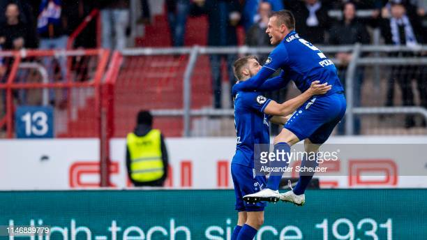 Marvin Pourie of Karlsruhe celebrates the first goal for his team with his teammates during the 3. Liga match between Karlsruher SC and SG Sonnenhof...