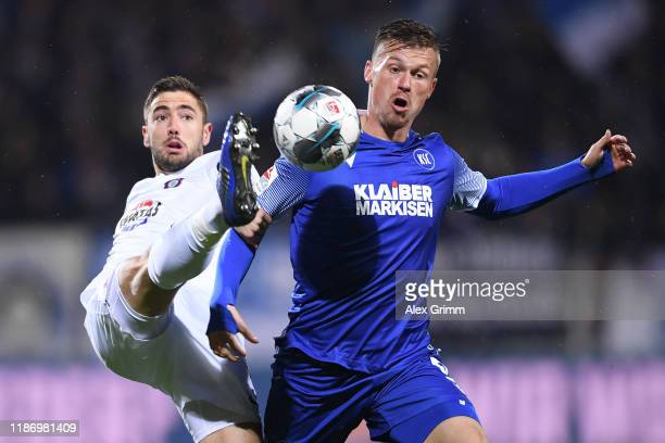 Marvin Pourie of Karlsruhe is challenged by Marko Mihojevic of Aue during the Second Bundesliga match between Karlsruher SC and FC Erzgebirge Aue at...