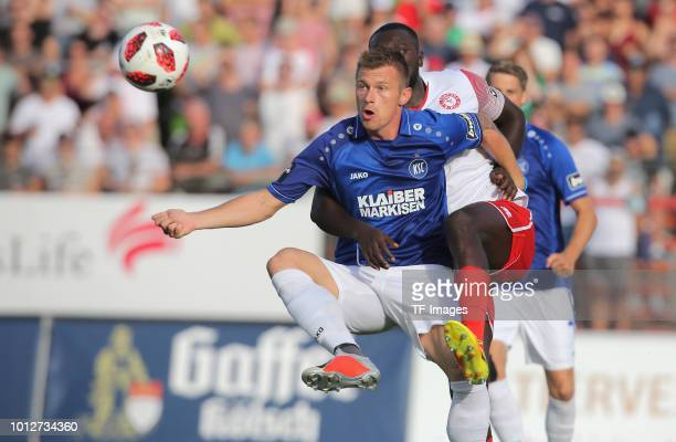 Marvin Pourie of Karlsruher SC battle for the ball during the 3 Liga match between SC Fortuna Koeln and Karlsruher SC at Suedstadion on August 7 2018...