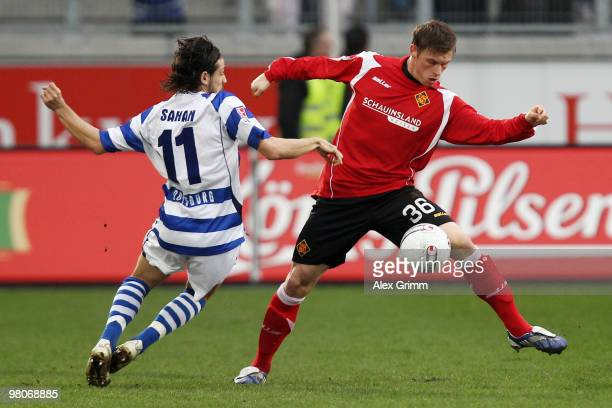 Marvin Pourie of Koblenz is challenged by Olcay Sahan of Duisburg during the Second Bundesliga match between MSV Duisburg and TuS Koblenz at the MSV...