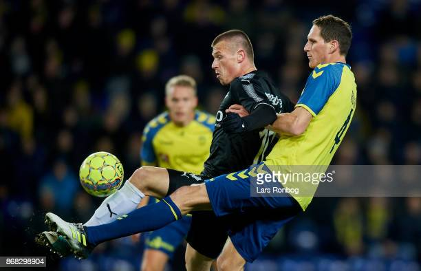 Marvin Pourie of Randers FC and Benedikt Rocker of Brondby IF compete for the ball during the Danish Alka Superliga match between Brondby IF and...