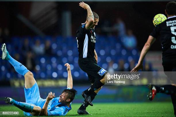 Marvin Pourie of Randers FC and Dennis Flinta of Silkeborg IF compete for the ball during the Danish Alka Superliga match between Randers FC and...