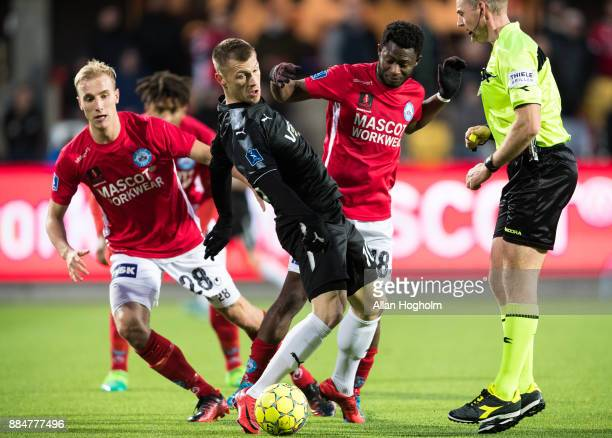 Marvin Pourie of Randers FC and Ibrahim Moro of Silkeborg IF compete for the ball during the Danish Alka Superliga match between Silkeborg IF and...