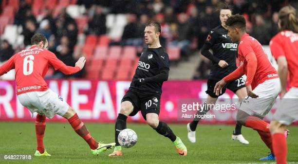 Marvin Pourie of Randers FC and JensMartin Gammelby of Silkeborg compete for the ball during the Danish Alka Superliga match between Silkeborg IF and...