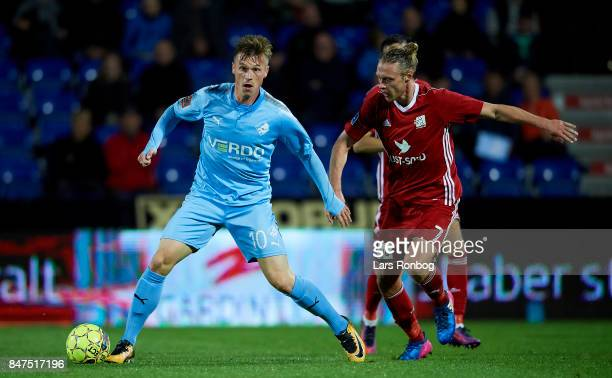 Marvin Pourie of Randers FC and Jesper Christjansen of Lyngby BK compete for the ball during the Danish Alka Superliga match between Randers FC and...