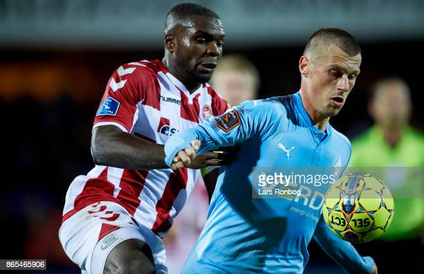 Marvin Pourie of Randers FC and Jores Okore of AaB Aalborg compete for the ball during the Danish Alka Superliga match between Randers FC and AaB...