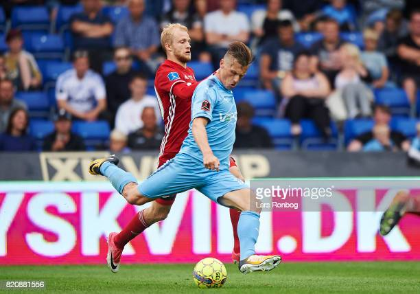 Marvin Pourie of Randers FC and Nicolai Boilesen of FC Copenhagen compete for the ball during the Danish Alka Superliga match between Randers FC and...