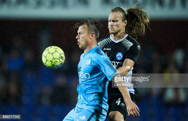 Marvin Pourie of Randers FC and Simon Jakobsen of Silkeborg IF compete for the ball during the Danish Alka Superliga match between Randers FC and...